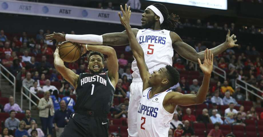 LA Clippers forward Montrezl Harrell (5) fouls on Houston Rockets guard Michael Carter-Williams (1) while Carter-Williams is going for the basketball during the first quarter of the NBA game at Toyota Center on Friday, Oct. 26, 2018, in Houston. Photo: Yi-Chin Lee/Staff Photographer