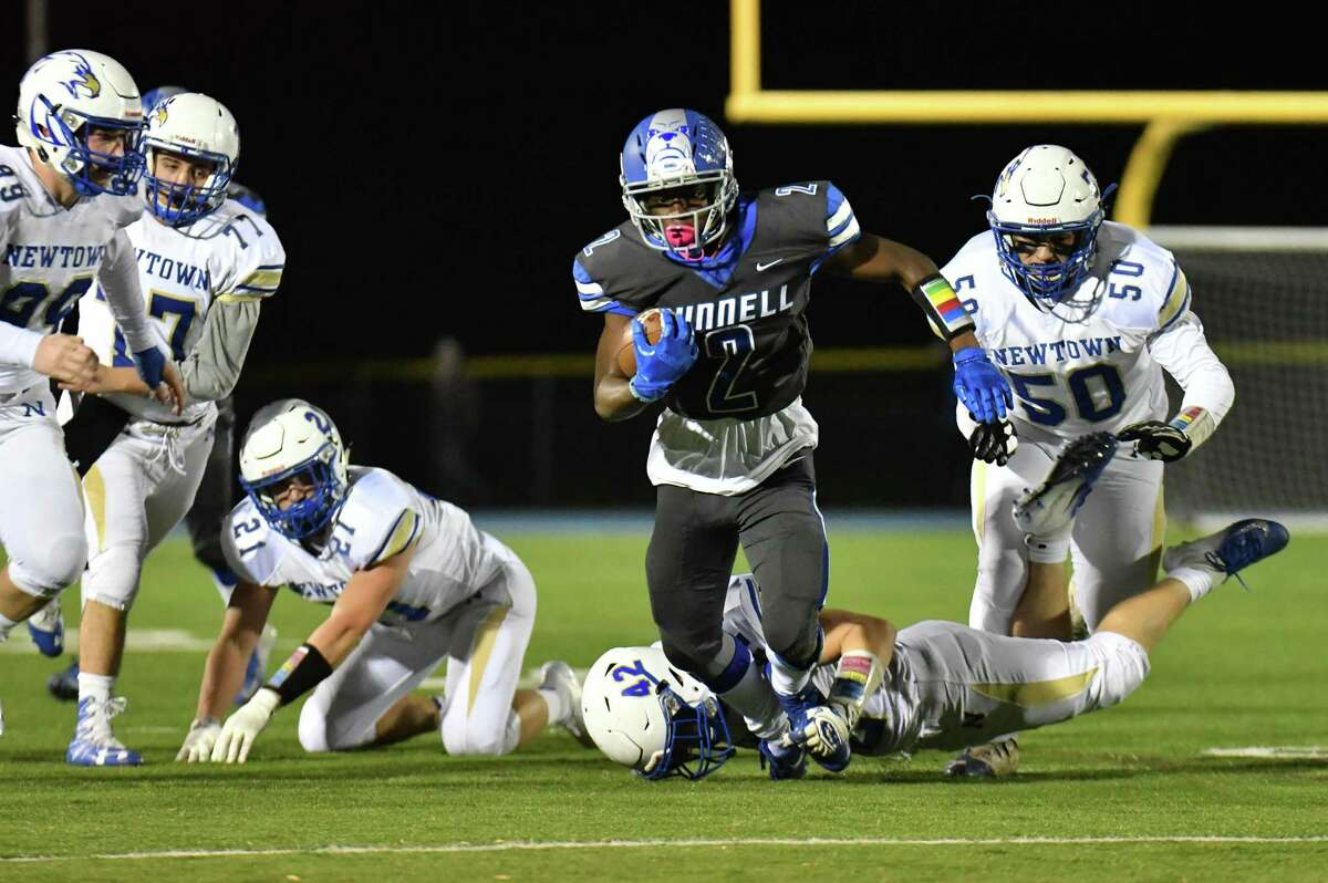 Eli Alexandre (2) of the Bunnell Bulldogs finds a hole for a big gain during a game against the Newtown Nighthawks on Friday October 26, 2018, at Bunnell High School in Stratford, Connecticut.