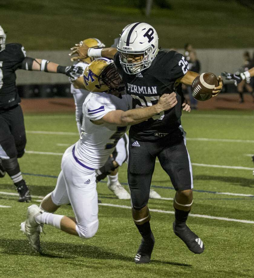 Odessa Permian quarterback Peyton Powell (25) attempts to get away from Midland High's Marshall Mayfield (54) Friday night. Photo: Jacy Lewis/191 News