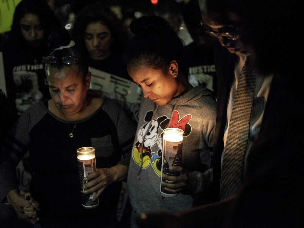 Patricia Slack, mother of Charles Roundtree Jr., center, and Arlene Castillo, grandmother to Roundtree, left, pray together during a protest outside of the San Antonio Police's Public Safety Headquarters on Friday, October 26, 2018. The protest is being held to call attention to the death of 18-year-old Charles