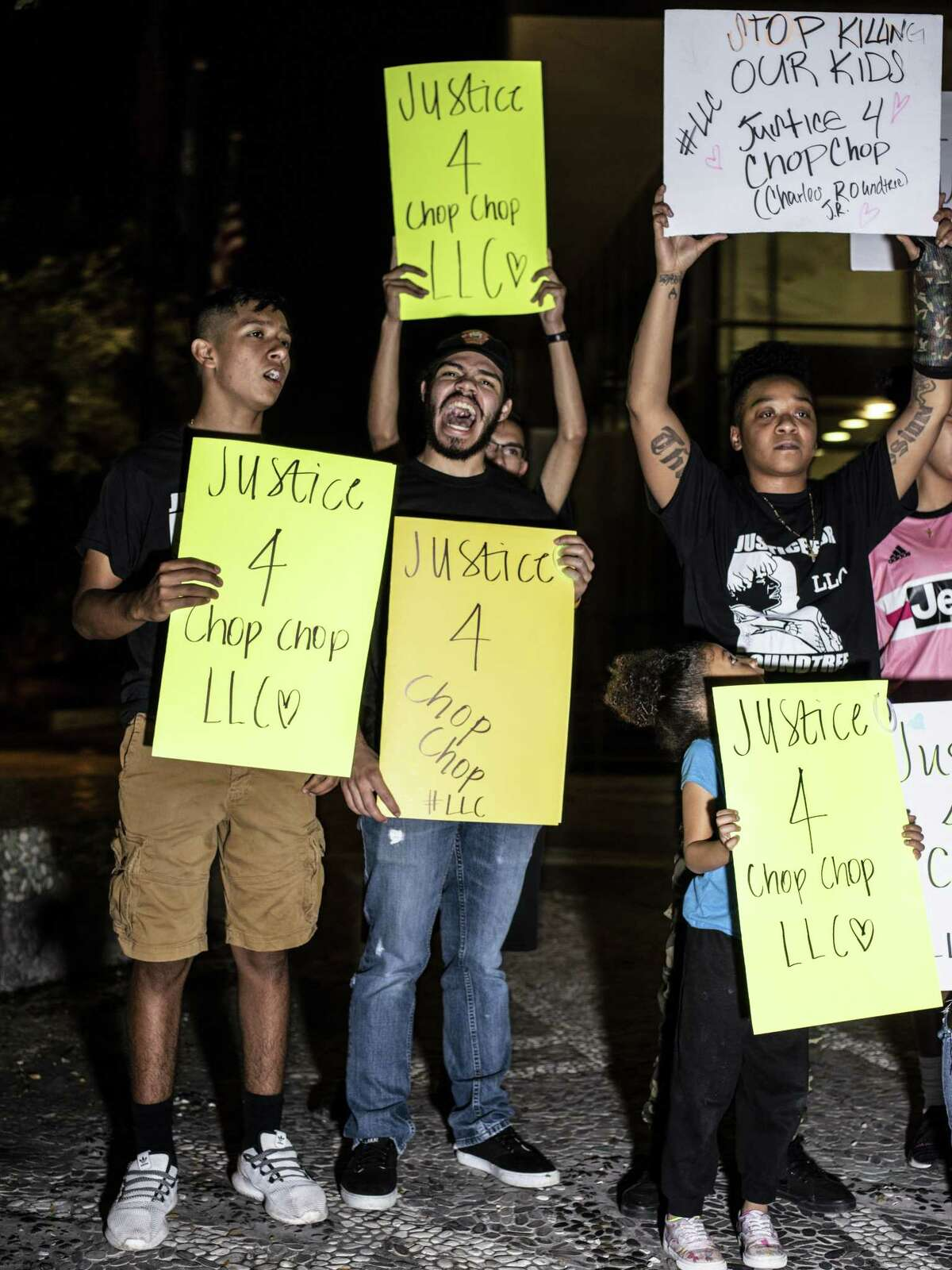 Friends and family of the late Charles Roundtree Jr. hold signs during a protest outside of the San Antonio Police's Public Safety Headquarters on Friday, October 26, 2018. The protest is being held to call attention to the death of 18-year-old Charles