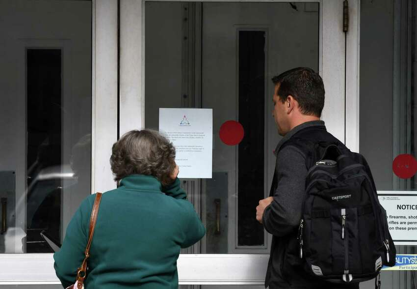 People looking to use the Cohoes Community Center read a sign on the door which announced its closure on Friday, Oct. 26, 2018, in Albany, N.Y. (Will Waldron/Times Union)