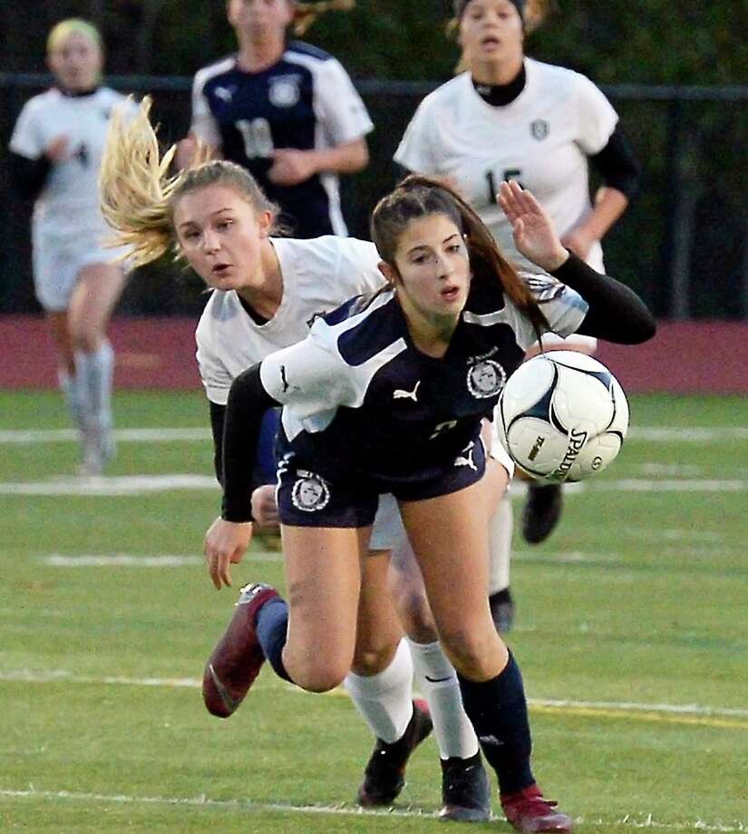 Schalmont's #6 Jules Monlea, left, and Holy Names' #2 Samantha Grmano chase the ball during their Class B girls'  final Friday Oct. 26, 2018 in Stillwater, NY.  (John Carl D'Annibale/Times Union) Photo: John Carl D'Annibale / 20045243A