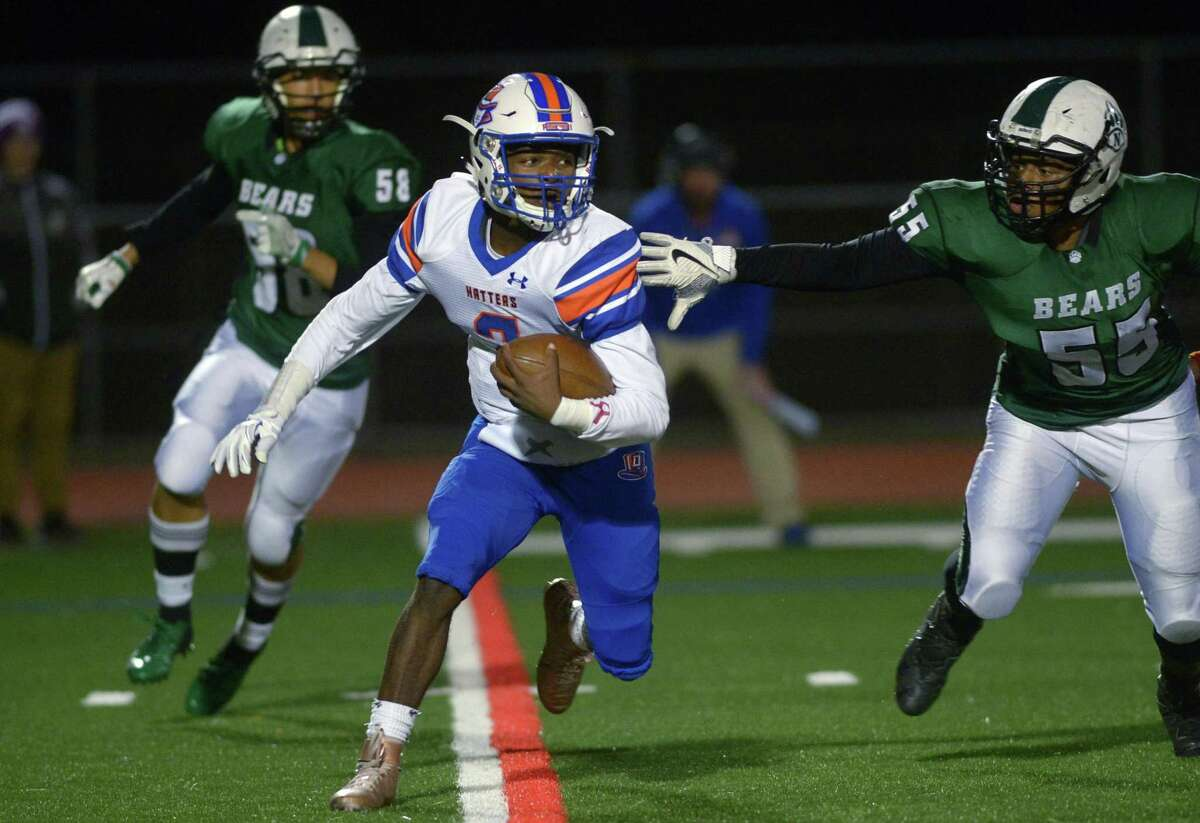 Danbury's Malachi Hopkins runs the ball against Norwalk on Friday. For complete results, please visit www.gametimect.com.