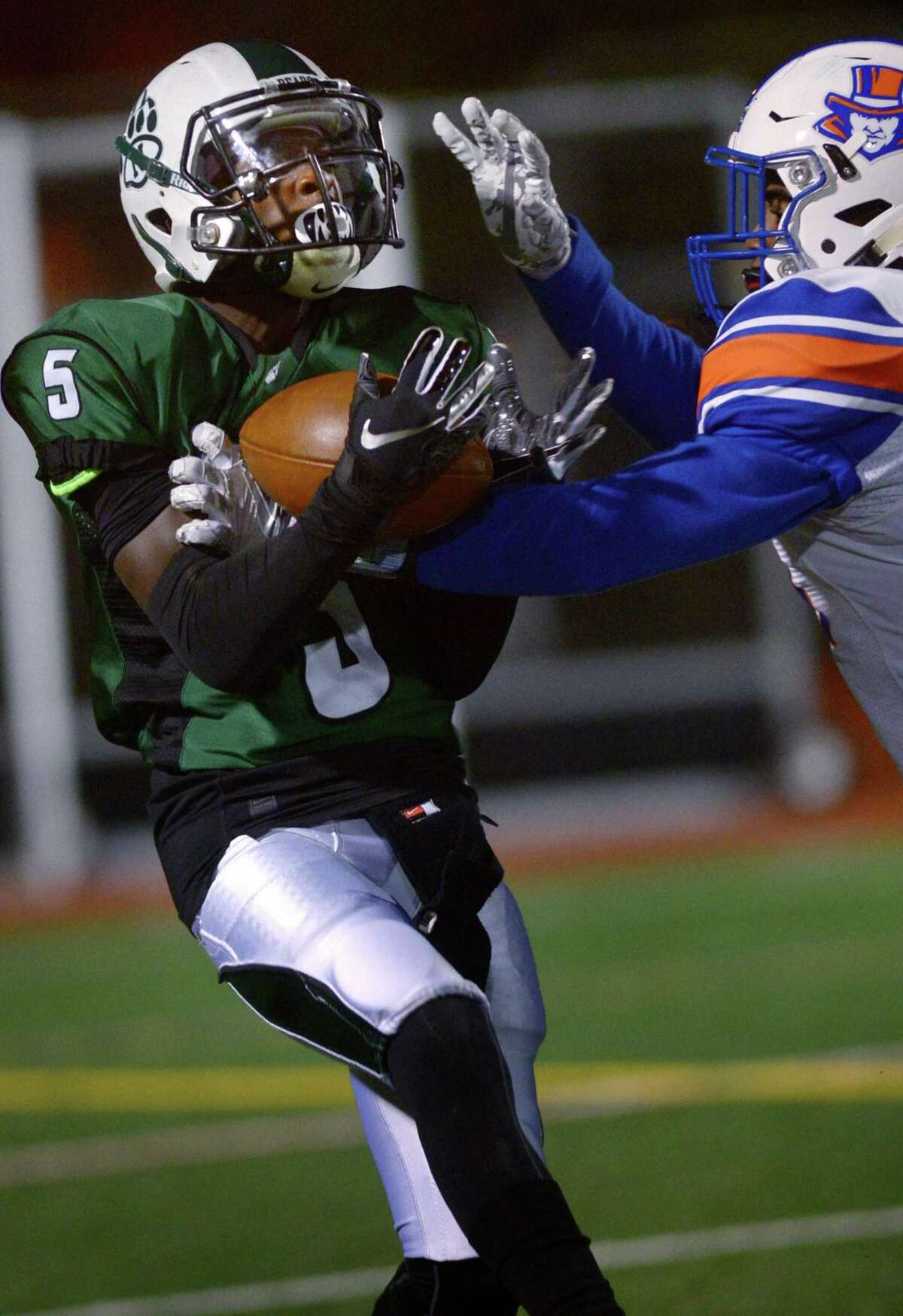 Bears #5 Jaki Elliott comes down with a long pass as the Norwalk High School Bears take on the Danbury High School Hatters during their FCIAC football game Friday, October 26, 2018, in Norwalk, Conn.
