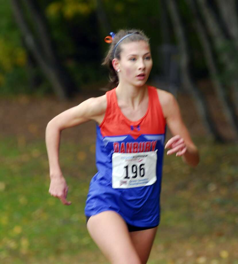 Danbury's Lauren Moore took second in the Class LL championships on Friday at Wickham Park in Manchester. Photo: Ryan Lacey /Hearst Connecticut Media