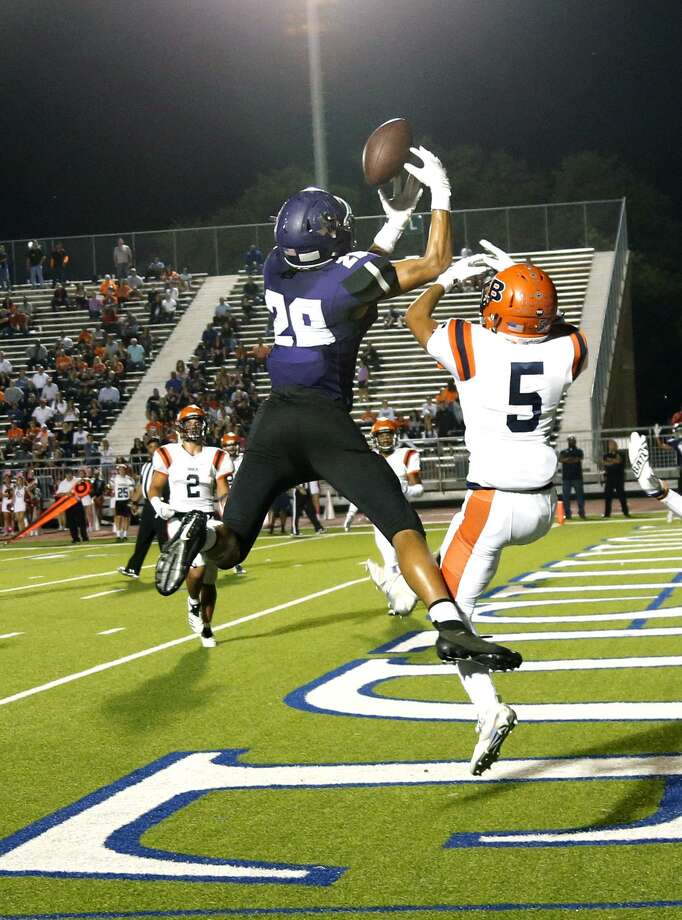 Warren Eric Rascoe goes up for a TD pass as Austin Garcia defends and knocked it away but Rascoe caught it while lying on his back. Brandeis vs. Warren at Gustafson Stadium on Friday, October 26, 2018 Photo: Ronald Cortes/Contributor / 2018 Ronald Cortes