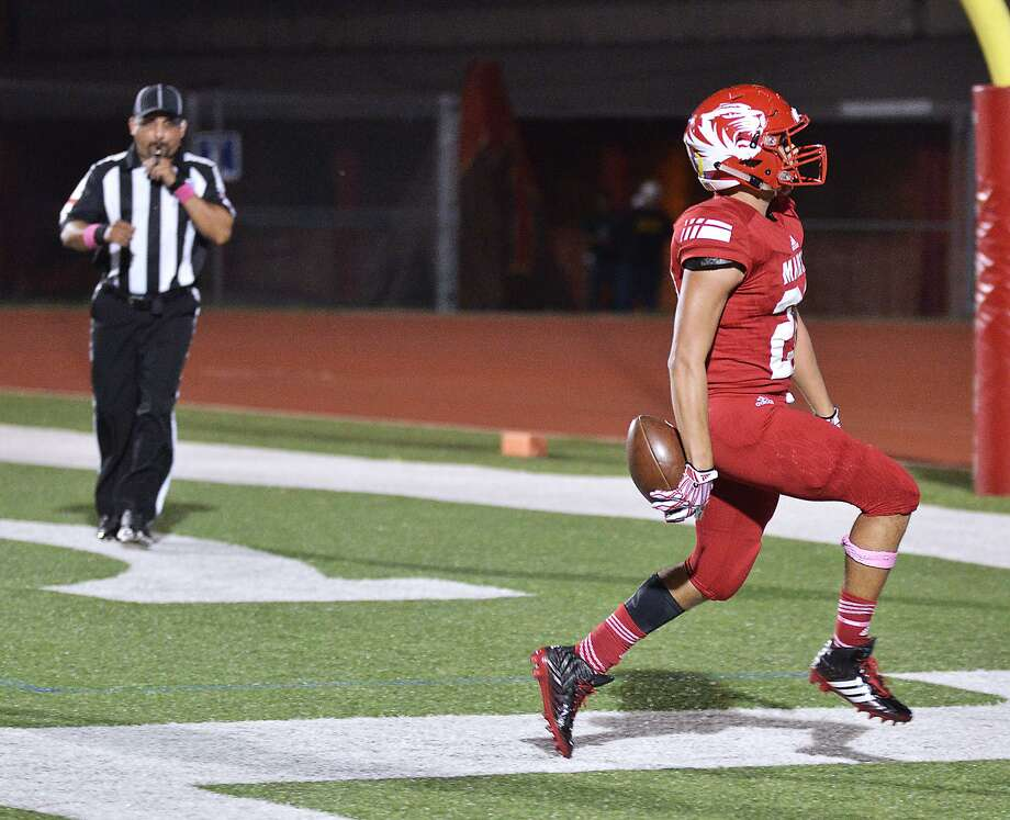 Running back Jose Castaneda ran for 85 yards and two touchdowns in Martin's win over McCollum Friday night. Photo: Cuate Santos /Laredo Morning Times / Laredo Morning Times