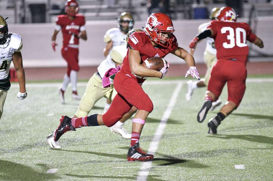 Martin's Jose Castaneda took over at quarterback in the second half Friday after Mathew Duron was injured and threw a 74-yard touchdown pass to his older brother Jorge. Castaneda passed for 102 yards and rushed for another 106 yards with one score. Photo: Cuate Santos /Laredo Morning Times File / Laredo Morning Times