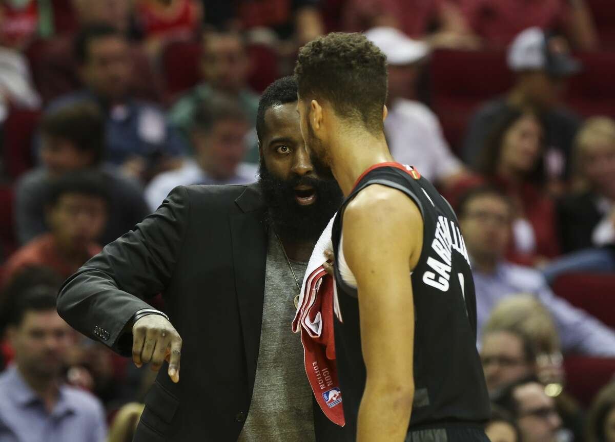 Houston Rockets guard James Harden talks to Houston Rockets guard Michael Carter-Williams (1) from the sideline during the first quarter of the NBA game against the LA Clippers at Toyota Center on Friday, Oct. 26, 2018, in Houston.