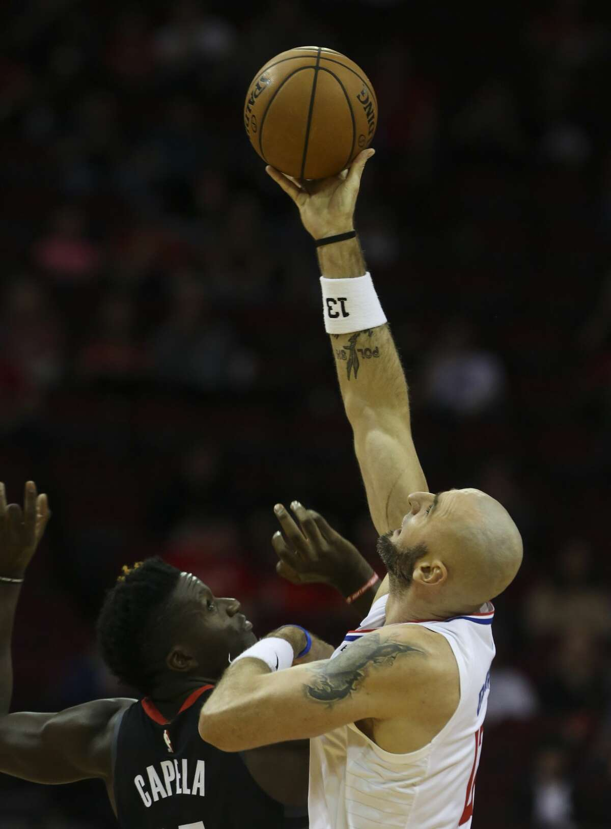 LA Clippers center Marcin Gortat (13) wins the jump up against Houston Rockets center Clint Capela (15) at the opening of the NBA game at Toyota Center on Friday, Oct. 26, 2018, in Houston.
