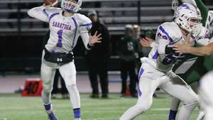 Saratoga Springs Blue Streak quarterback Jake Williams connects with Christian Kondo during the Section II Class AA semifinal football matchup at Shenendehowa High School Friday, October 26, 2018. (Ed Burke photo-Special to The Times Union)
