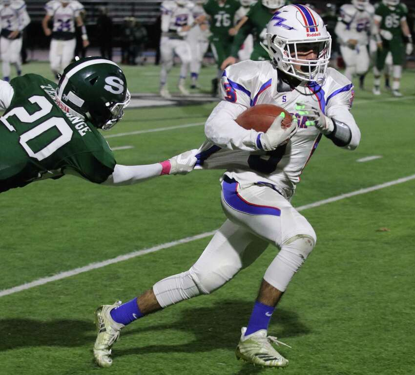 Tight grip by Shen's Dyvante Terrelonge eventually stops Saratoga's Christian Kondo during the Section II Class AA semifinal football matchup at Shenendehowa High School Friday, October 26, 2018. (Ed Burke photo-Special to The Times Union)