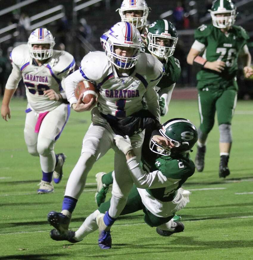 Running a keeper, Saratoga's QB Jake Williams is stopped by Shen defender Jaden Sebring during the Section II Class AA semifinal football matchup at Shenendehowa High School Friday, October 26, 2018. (Ed Burke photo-Special to The Times Union)