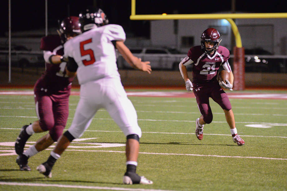 TOP TAILBACK Abernathy senior tailback Kole Carlisle (right) picks up extra yardage to surpass 1,000 yards on the season against Colorado City during Distrist 2-3A football action on Friday night in Abernathy. Carlisle scored a 61-yard touchdown to help the Antelopes beat the Wolves, 40-0. Photo: Photo Courtesy Of RinaRae Photography
