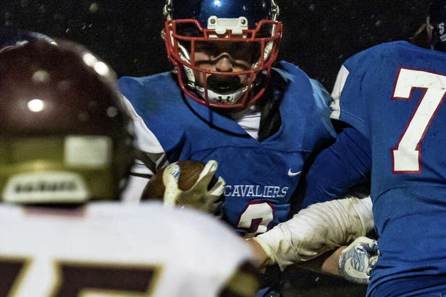 Having faced minimal adversity through a sparkling 9-0 regular season, the Carlinville Cavaliers got hit with a little dose of it Friday night against East Alton-Wood River. When the Oilers scored early in the third quarter to cut a Cavaliers lead down to six, it certainly got the attention of the state's second-ranked team in Class 3A.
