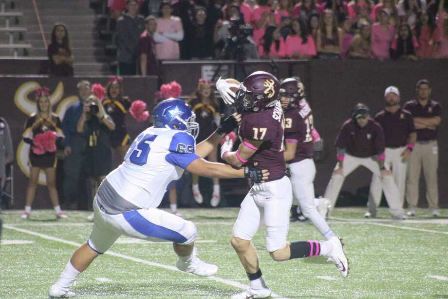 Luke Schaper confronts a Baytown Sterling player en route to his pick-six that gave Deer Park the lead for good Friday night. Photo: Robert Avery