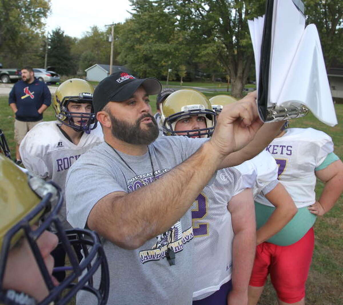 Routt football coach Barry Creviston goes over a play with his players during practice earlier this week.