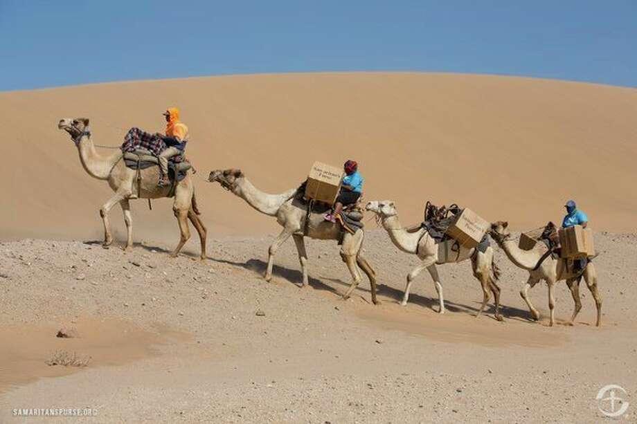 Transportation by camel in Namibia / ©2016 Samaritan's Purse