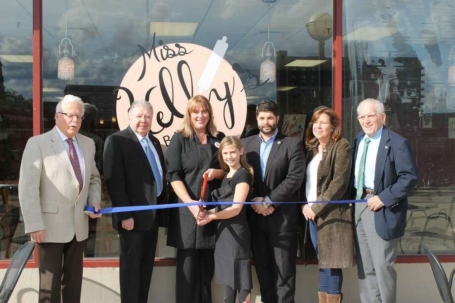 Miss Kelly's Bakery and Cafe held a grand opening last week at 100 Riverview Center in Middletown. From left are Middletown Small Business Counselor Paul Dodge, Middlesex County Chamber of Commerce Chairman Jay Polke, Owner Kelly Travers and her daughter Isabelle, Mayor Dan Drew, Lisa Melaven of the Downtown Business District and Chamber President Larry McHugh. Photo: Contributed Photo
