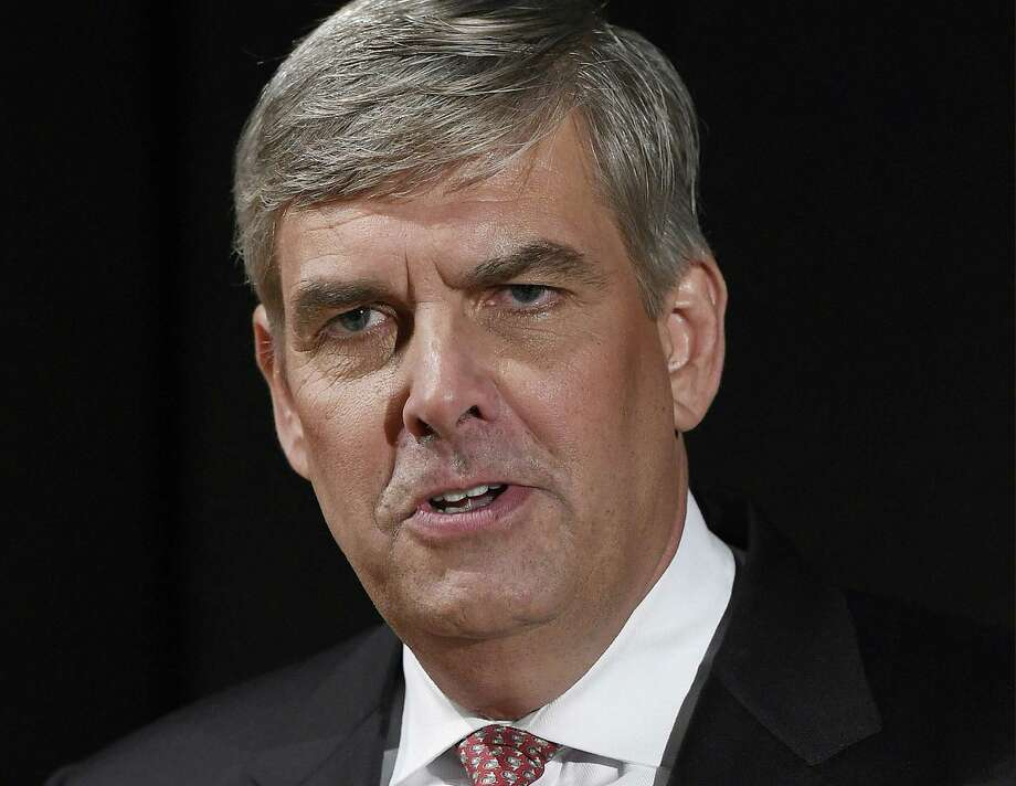 FILE - In this Sept. 26, 2018, file photo, Republican businessman Bob Stefanowski speaks to the media after gubernatorial debate at the University of Connecticut in Storrs, Conn. Stefanowski touts his work at blue-chip companies like General Electric and UBS Investment Bank. Rivals criticized the most recent item on his resume: CEO of DFC Global company, which offers financial products that are not legal in Connecticut. Stefanowski counters that his experience straightening out the troubled company would serve him well fixing the state's stubborn budget deficits. (AP Photo/Jessica Hill, File) Photo: Jessica Hill / Associated Press / Copyright 2018 The Associated Press. All rights reserved