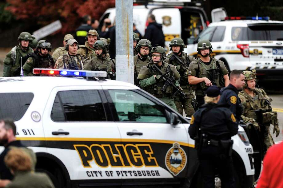 Law enforcement officers secure the scene where multiple people were shot, Saturday, Oct. 27, 2018, at the Tree of Life Congregation in Pittsburgh's Squirrel Hill neighborhood. (Alexandra Wimley/Pittsburgh Post-Gazette via AP) Photo: Alexandra Wimley, AP / Pittsburgh Post-Gazette