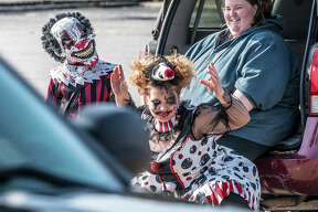 A pair of especially ghoulish clowns taunt a passing pickup truck traveling along Wood River Avenue Saturday morning while waiting for the city's annual Halloween Parade to begin. Hundreds turned out for the event, held under sunny skies. A mix of characters travels along Wood River Avenue Saturday morning for the city's annual Halloween Parade. Hundreds turned out for the event, held under sunny skies.