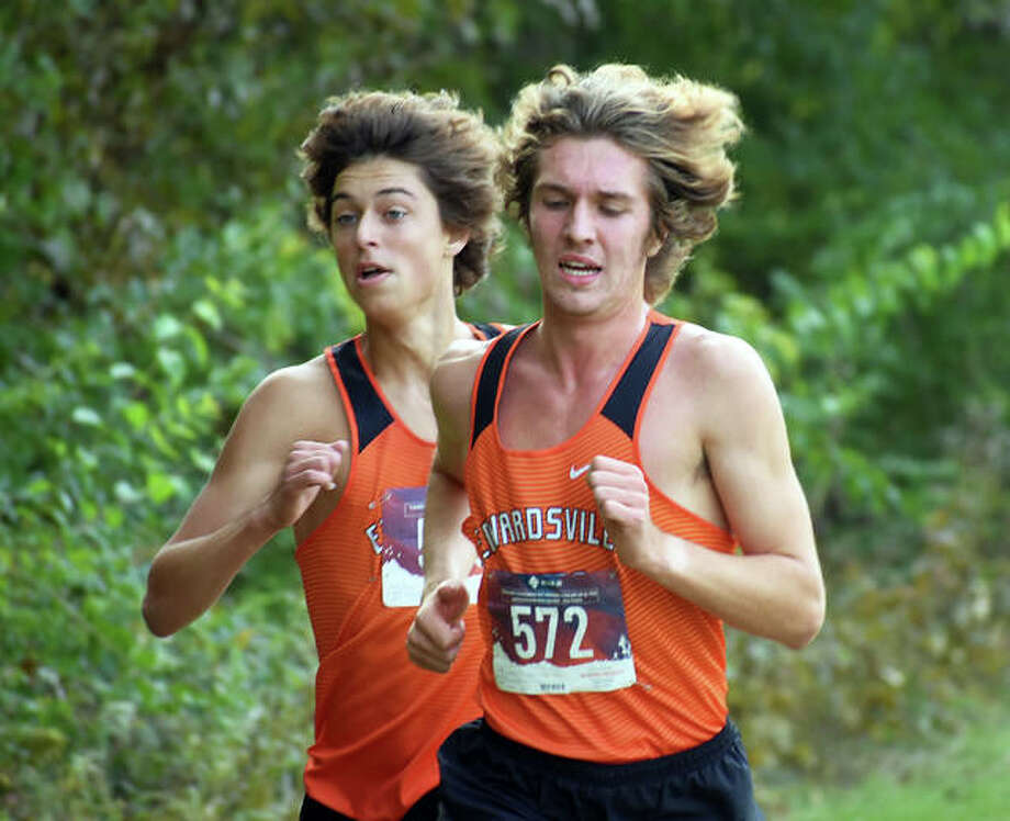 Edwardsville's Max Hartmann, left, and Roland Prenzler near the second-mile mark of the Class 3A Quincy Sectional on Saturday inside Bob Mays Park in Quincy. Photo: Matt Kamp/Intelligencer