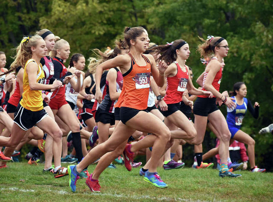 Edwardsville's Abby Korak, center front, races out in front of the field at the start of Class 3A Quincy Sectional on Saturday at Bob Mays Park in Quincy. Photo: Matt Kamp/Intelligencer