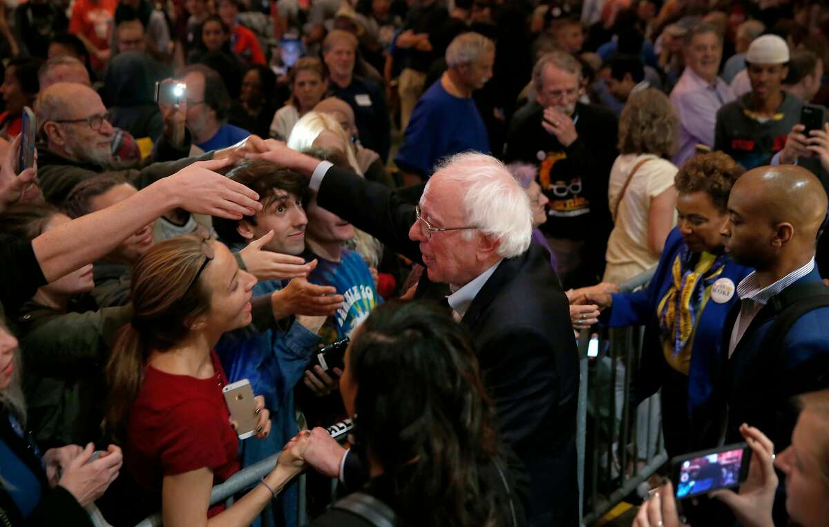 Vermont Sen. Bernie Sanders greets supporters after appearing at a campaign rally for Rep. Barbara Lee at the Berkeley Community Theater in Berkeley, Calif. on Saturday, Oct. 27, 2018.