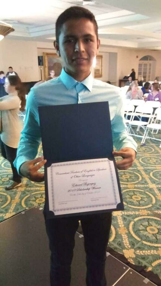 Edward Bojorquez is awarded a $1,000 scholarship from ConnTESOL at the organization's 48th annual conference at the University Center in Hartford. He is a 2018 graduate of Greenwich High and a student at UConn-Stamford. Photo: /