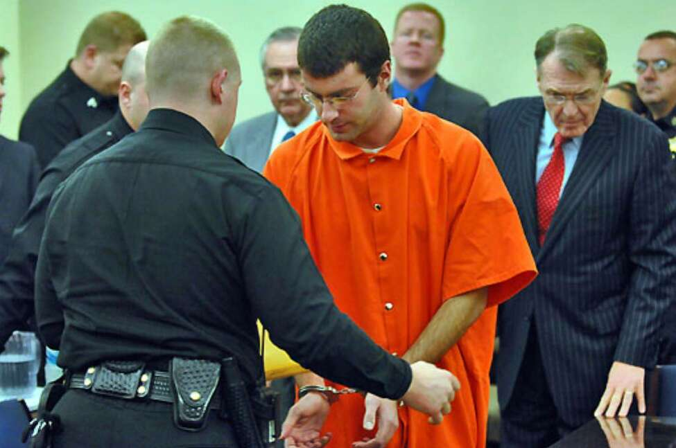 Albany County Sheriff's deputies handcuff Christopher Porco before his sentencing at the Albany County Courthouse today.