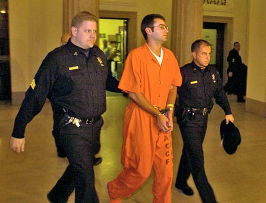 Christopher Porco is led into the Albany County Courthouse  for a bail hearing Wednesday. Photo: Philip Kamrass