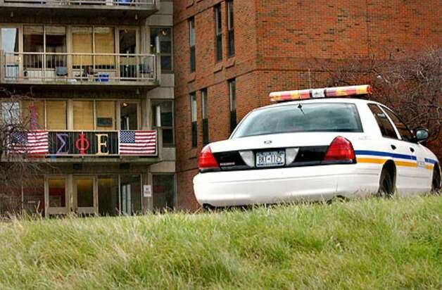 A patrol car is stationed around the clock outside the Sigma Phi Epsilon fraternity at the University of Rochester. Photo: Cindy Schultz