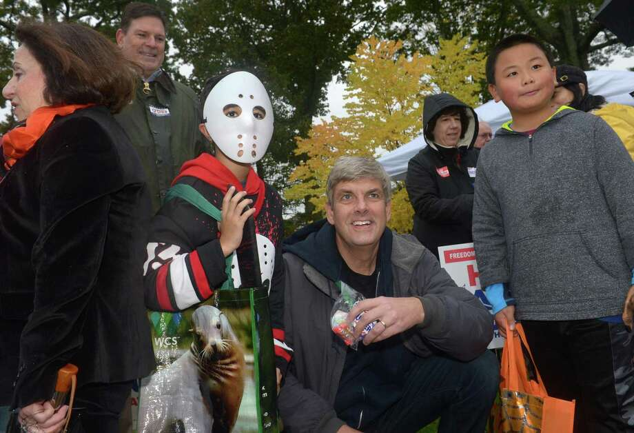 Republican gubernatorial candidate Bob Stefanowski gives out candy to Dylan Araujo, of Wilton, and Andre Sun, of Westport, both 10, while on the campaign trail at the annual Halloween Trick or Treat Parade on Saturday in Wilton. Photo: Erik Trautmann / Hearst Connecticut Media / Norwalk Hour