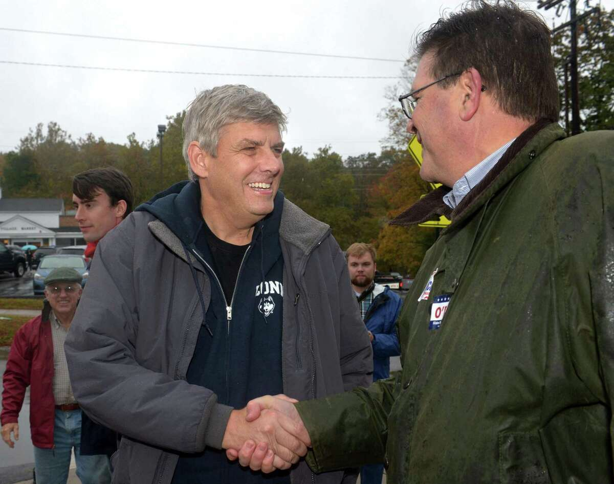 Republican gubernatorial candidate Bob Stefanowski greets State Representative for the 125th District Tom O'Dea while on the campaign trail at the annual Halloween Trick or Treat Parade on Saturday in Wilton.