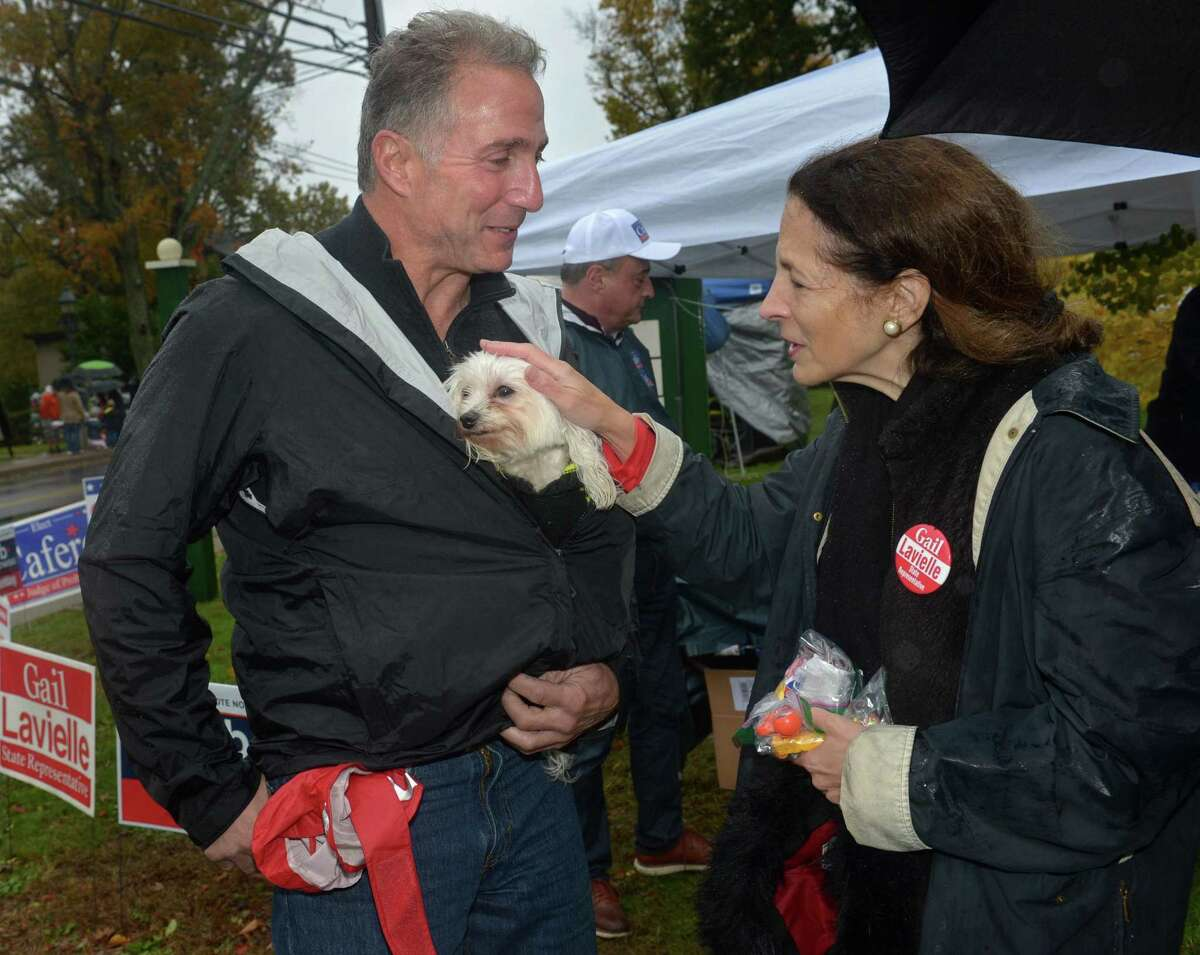 Republican candidate for US Senator for Connecticut Matthew Corey and his dog Miley are greeted by State Representative Gail Lavielle while Corey was on the campaign trail! at the annual Halloween Trick or Treat Parade Saturday, October 27, 2018, in Wilton, Conn.
