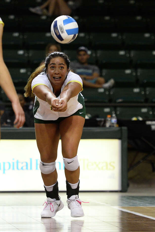 Midland College's Lauren Watanabe (14) keeps the ball alive against New Mexico Military Institute Oct. 27, 2018 at Chapparal Center. James Durbin/Reporter-Telegram Photo: James Durbin / ? 2018 Midland Reporter-Telegram. All Rights Reserved.