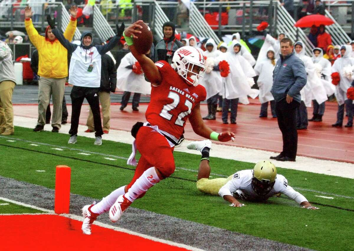 Sacred Heart University's Jordan Meachum scores on a 71-yard touchdown run against Bryant on Saturday in Fairfield. Meachum set the ingle-game rushing record for the Pioneers with 318 yards.