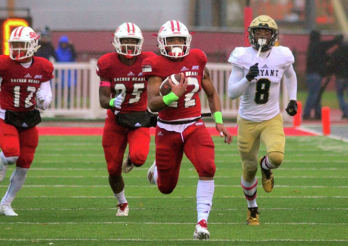 Sacred Heart University's Jordan Meachum (22) breaks away to run 71 yards for a touchdown during college football action against Bryant in Fairfield, Conn. on Saturday Oct. 27, 2018.