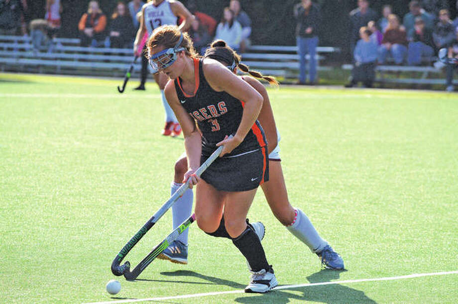 Edwardsville senior Skyler Romano tries to keep the ball away from a Villa Duchesne player during Saturday's second-round game at Villa Duchesne in the Midwest Field Hockey Tournament. Photo: Scott Marion/Intelligencer