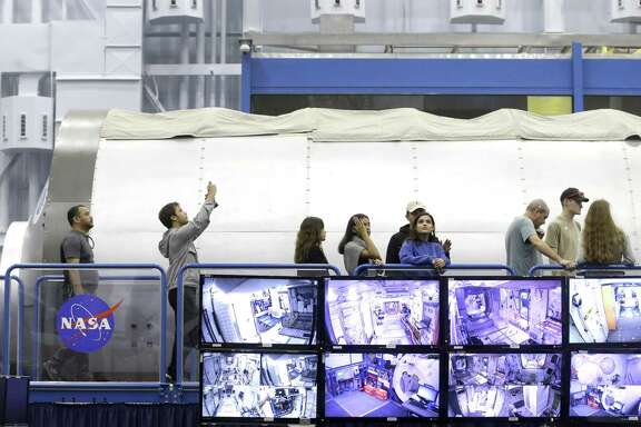 People tour mockup sections of the International Space Station at the Space Vehicle Mockup Facility in Building 9NW during the open house at NASA Johnson Space Center Saturday, Oct. 27, 2018, in Houston.