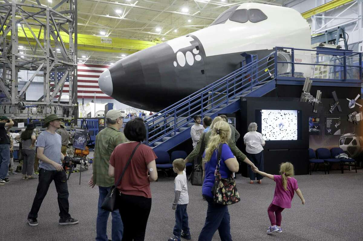 People tour in the Space Vehicle Mockup Facility at Building 9NW during the open house at NASA Johnson Space Center Saturday, Oct. 27, 2018, in Houston.