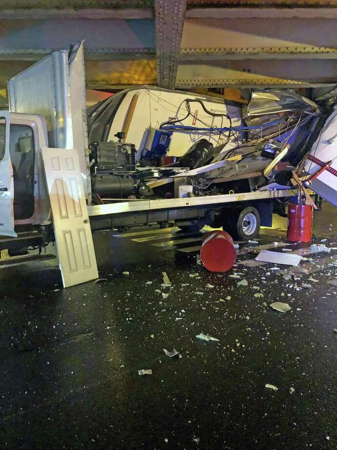 A truck strikes the Washington Street bridge in Norwalk, Conn., on Oct. 27, 2018. Photo: Contributed Photo / Norwalk Police Department / Contributed Photo / Connecticut Post Contributed
