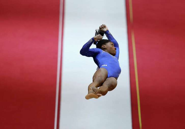 DOHA, QATAR - OCTOBER 27: Simone Biles of USA competes in the Women's Vault Qualification during day three of the 2018 FIG Artistic Gymnastics Championships at Aspire Dome on October 27, 2018 in Doha, Qatar. (Photo by Francois Nel/Getty Images)