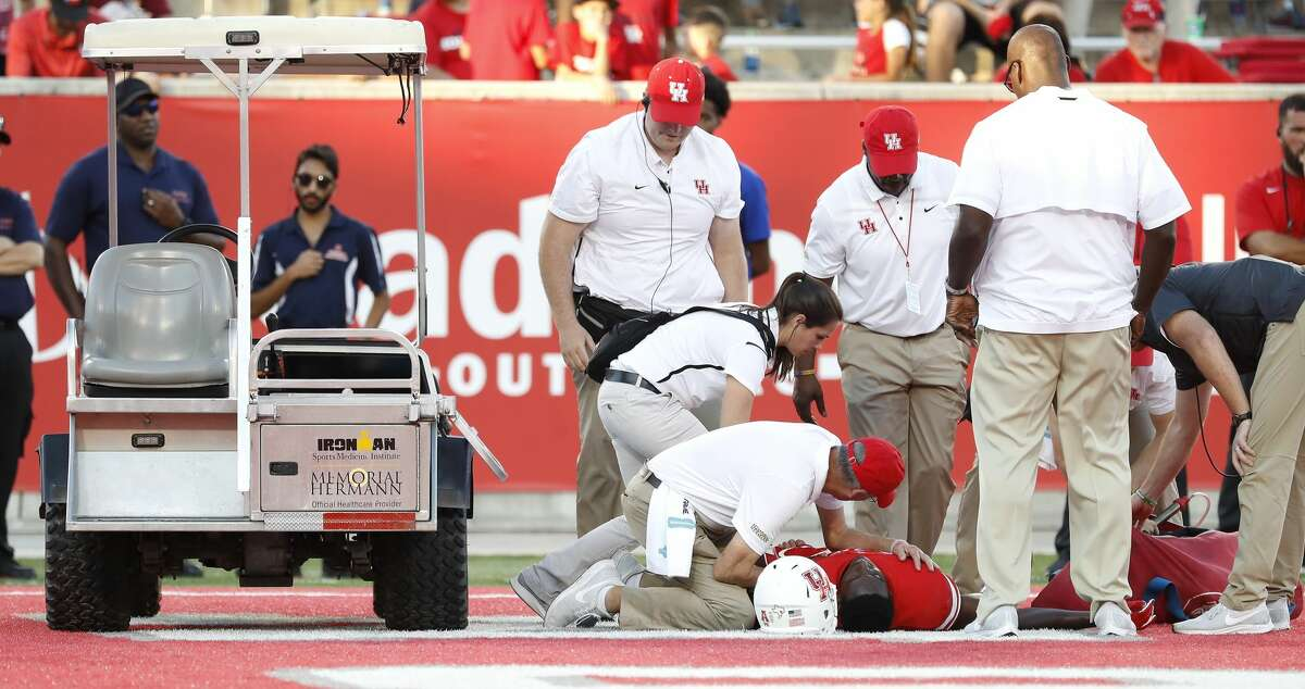 Houston Cougars wide receiver Courtney Lark (9) is tended to after being injured on a play in the endzone during the second half of a college football game at TDECU Stadium, Saturday, Oct. 27, 2018, in Houston.