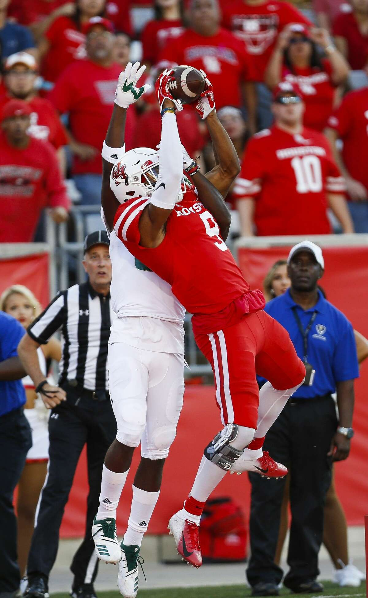 Houston Cougars wide receiver Courtney Lark (9) catches an interception in the end zone in front of South Florida Bulls wide receiver Zion Roland (82) during the second half as the Houston Cougars beat the South Florida Bulls 57-36 at TDECU Stadium Saturday, Oct. 27, 2018, in Houston.