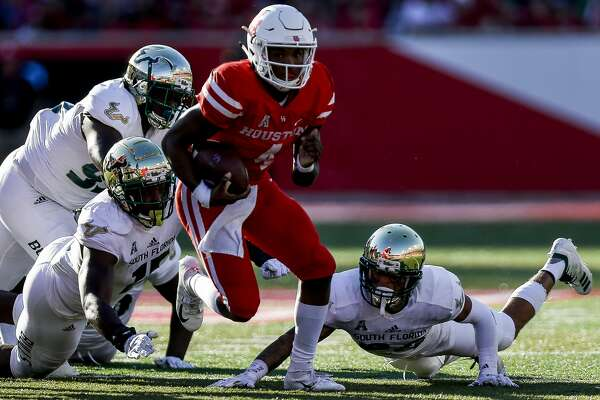 Houston Cougars quarterback D'Eriq King (4) runs for a touchdown during the second half as the Houston Cougars beat the South Florida Bulls 57-36 at TDECU Stadium Saturday, Oct. 27, 2018, in Houston.