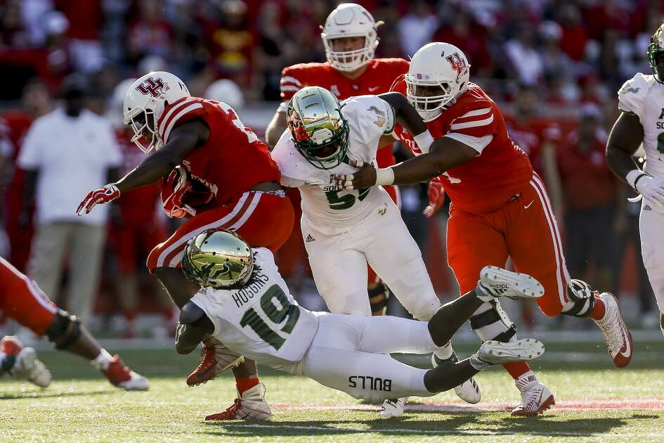 South Florida Bulls cornerback Ronnie Hoggins (19) tackles Houston Cougars running back Patrick Carr (21) during the second half as the Houston Cougars beat the South Florida Bulls 57-36 at TDECU Stadium Saturday, Oct. 27, 2018, in Houston.