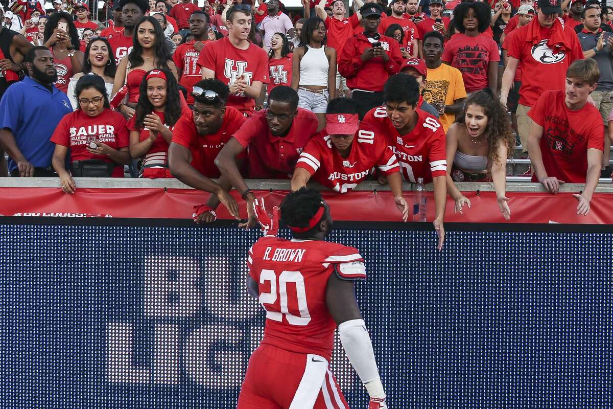 Houston Cougars linebacker Roman Brown (20) celebrates the 57-36 win against the South Florida Bulls with fans at TDECU Stadium Saturday, Oct. 27, 2018, in Houston.